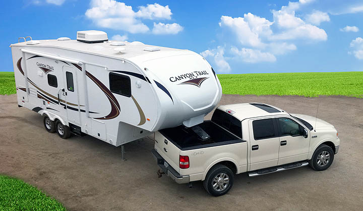 An image of a pickup and Canyon Trail Fifth Wheel from our archives (not currently in production)